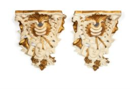 A pair of painted plaster wall brackets in George III style