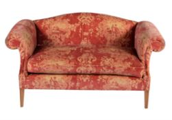 An upholstered sofa in George III style