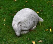 A sculpted limestone model of a crouching armadillo