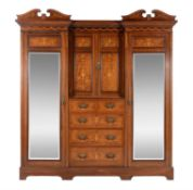An American walnut and marquetry inlaid compactum wardrobe