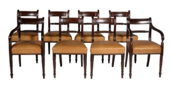 A set of six Regency mahogany and brass line inlaid dining chairs