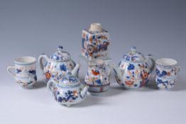 Three Chinese Imari teapots and covers