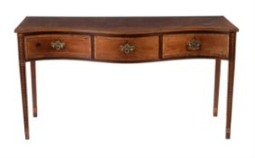 An Edwardian mahogany and inlaid sideboard