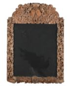 A carved limewood wall mirror in 18th century style