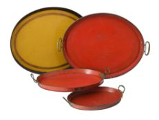 A Swedish set of three graduated hand painted tinware oval trays