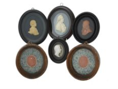 A collection of six assorted wax and composition portrait reliefs