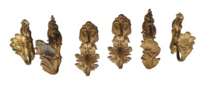Three pairs of French gilt bronze curtain tie backs in Rococo taste