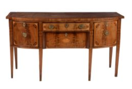 A mahogany and inlaid sideboard