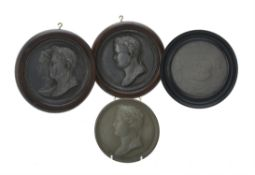 A pair of French lead portrait roundels of Napoleon