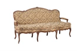 A Louis XV walnut and needlework upholstered sofa