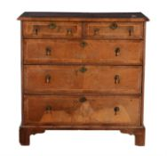 A George II walnut and feather banded chest of drawers