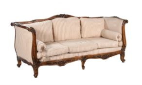 A French carved walnut and upholstered sofa or day bed