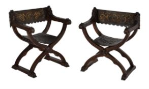 A pair of Italian carved walnut Savonarola armchairs