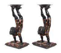 A pair of blackamoor side tables