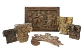 A group of five various carved wood fragments