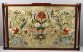An embroidered part silk floral needlework panel