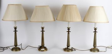 A modern set of four brass column table lights