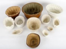 Twelve various pie and jelly moulds