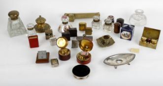 A collection of various antique and later inkwells and inkstands