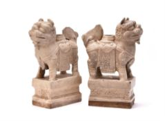 A pair of Chinese white glazed candle holders