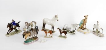 A collection of pottery and porcelain horse models