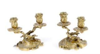 A pair of Louis XV style ormolu twin branch candelabra