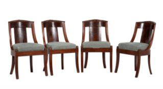 A set of four French Empire mahogany curve back side chairs