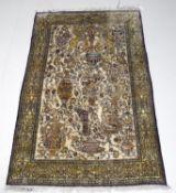 A Persian silk rug