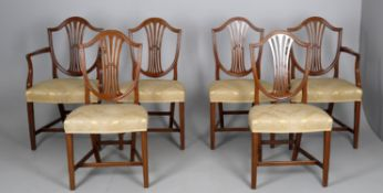 A set of six Hepplewhite style dining chairs
