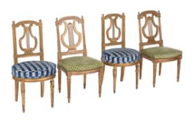 Two pairs of lyre back giltwood chairs
