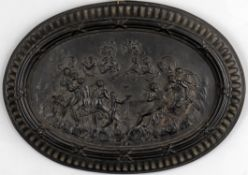 A black basalt plaque depicting the 'Feast of the Gods'
