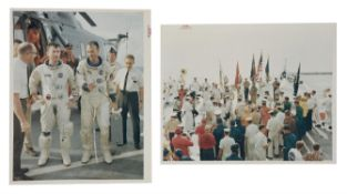 Two views of the crew onboard the recovery ship, USS Guadalcanal, Gemini 10, July 1966