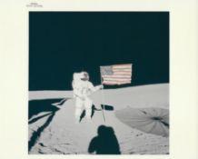 Alan Shepard beside the illuminated American flag, Apollo 14, February 1971