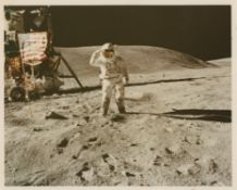 Charles Duke saluting the U.S. flag, Apollo 16