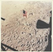 The view of the American flag from the 'Eagle's' window after the moonwalk, Apollo 11, July 1969