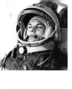 A set of seven early portraits of cosmonauts in their flight gear