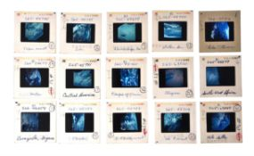 An assortment of early generation slides including Gemini and Apollo photography