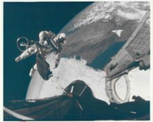 Ed White floats away from the spacecraft during the first American spacewalk, Gemini 4, June 1965