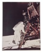 Buzz Aldrin descends the steps of ladder [large format], Apollo 11, July 1969