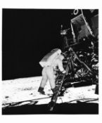Buzz Aldrin descends the steps of the Lunar Module's ladder, Apollo 11, July 1969