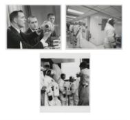 Three views of the crew preparing for the 10-day Earth orbit mission, Apollo 9, March 1969