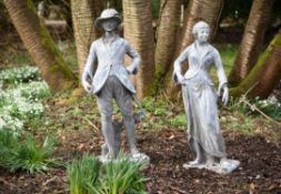 A pair of lead garden models of a pastoral couple