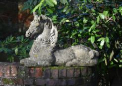 A pair of stone composition models of recumbent horses