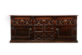 A Charles II oak dresser base