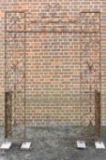 A large wrought iron archway, English or French, possibly 18th century