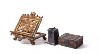 A North European carved oak and wrought iron bound offertory or alms box, 17th century