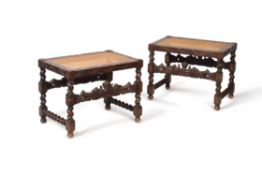 A pair of carved oak and caned stools, in Charles II style