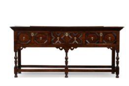 A Charles II oak dresser base, circa 1680