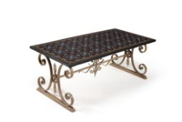 A Pietre Dure decorated marble table top ona wrought iron base