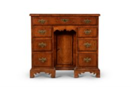 A walnut and line inlaid kneehole desk, mid 18th century